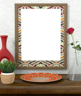 Quadro com ornamento étnico brilhante. grama verde em uma panela em uma mesa de madeira. rosa vermelha em um vaso de vidro.