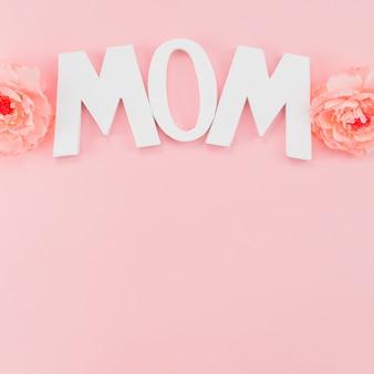 Quadro com título mamãe e peônias
