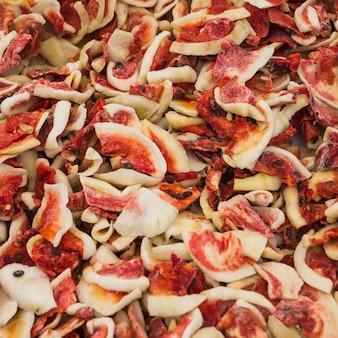 Quadro completo de fatias de frutas vermelhas deliciosas