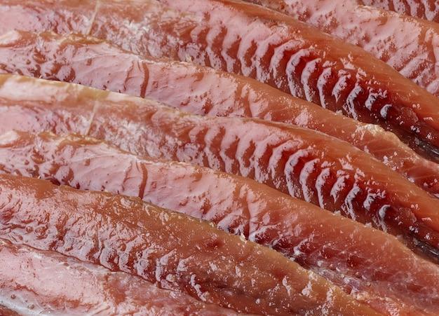 Quadro completo de filetes de anchova enlatados. fundo de peixe preparado