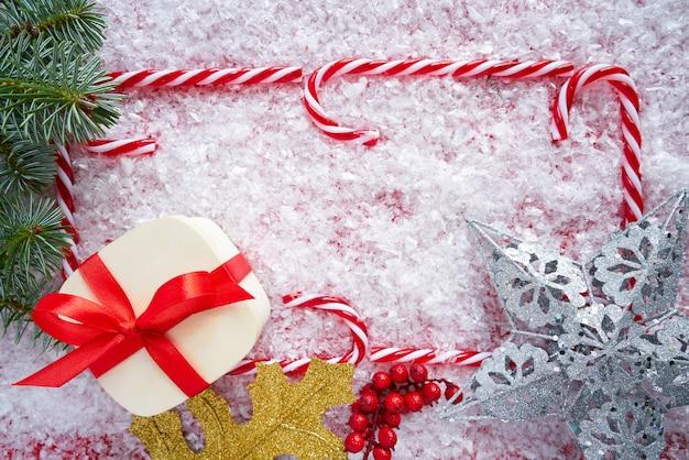 Quadro de bengala de doces de natal na neve