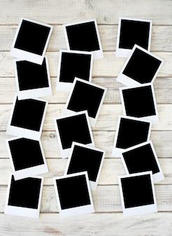 Quadro de fotos antigas, fotografia analógica, fundo branco de madeira