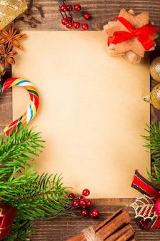 Quadro de lista de desejos com galhos de árvores de natal e decorações vintage
