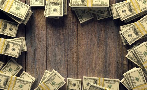 Quadro de notas de cem dólares com espaço de cópia para mock up em fundo de madeira