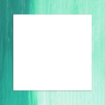 Quadro em branco com pincel de tinta verde fundo