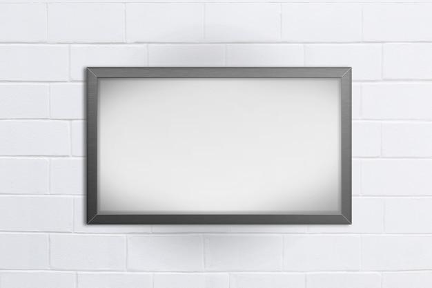 Quadro-negro vazio no fundo de tijolo branco