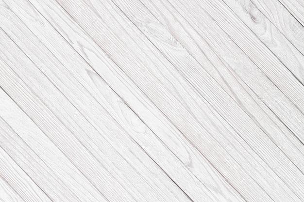 Quadros brancos como plano de fundo, textura leve de uma mesa ou piso de madeira