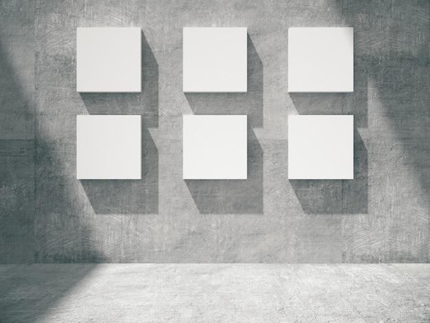 Quadros vazios penduram na parede de concreto
