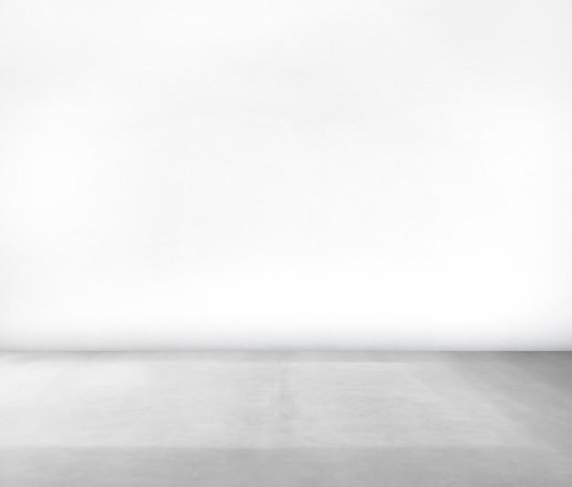 Quarto feito de parede branca e piso de concreto