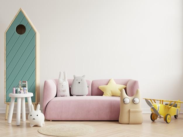 Quarto infantil em parede branca com sofá e almofadas
