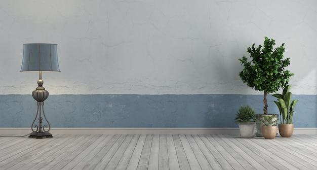 Quarto retrô vazio com parede velha azul e branca