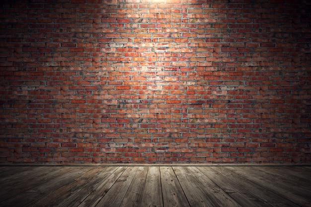 Quarto sujo velho vazio com parede de tijolo vermelho e piso de madeira