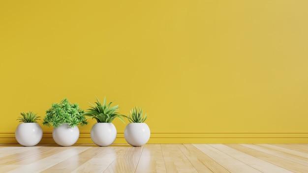 Quarto vazio amarelo com plantas no chão.