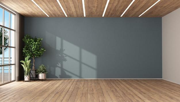 Quarto vazio com plantas e parede azul