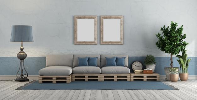 Quarto vintage azul e branco com sofá de paletes