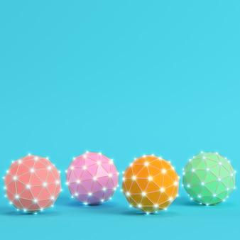 Quatro esferas coloridas abstratas de poliéster brilhante em fundo azul brilhante