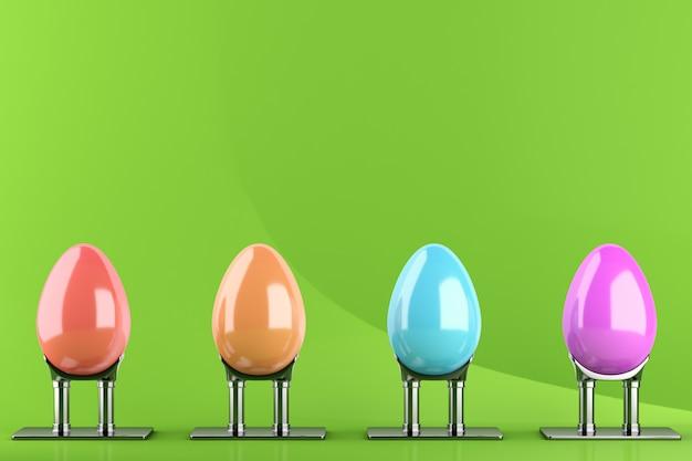 Quatro ovos de páscoa coloridos em suportes de metal