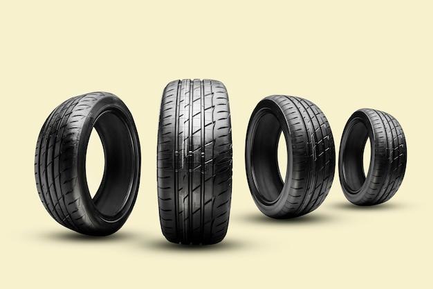 Quatro pneus de verão em um fundo amarelo
