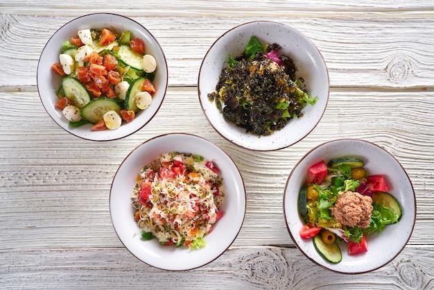 Quatro salada misture tigelas comida saudável