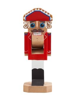 Quebra-nozes. brinquedo de natal de madeira isolado no fundo branco. vista frontal