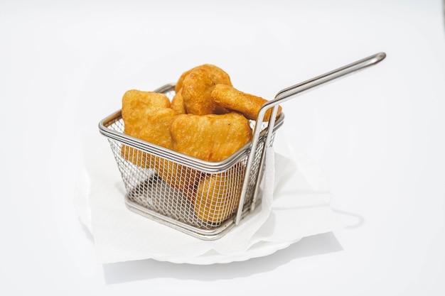 Ração de nuggets de frango em bar