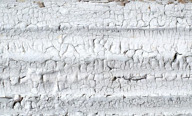Rachaduras em uma antiga parede pintada
