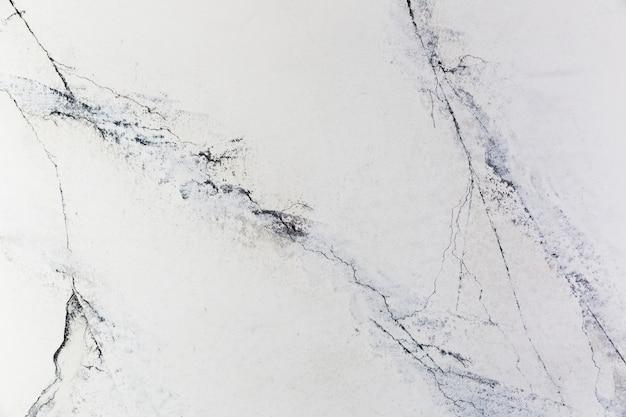 Rachaduras na superfície da parede de concreto