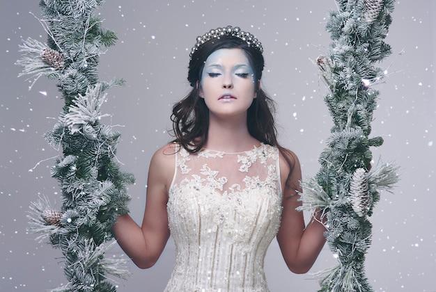 Rainha do gelo em paisagem invernal