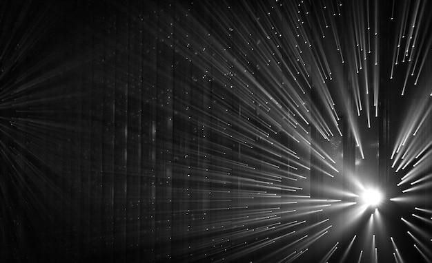 Raios de luz através de pequenos orifícios em um espaço de metal escuro