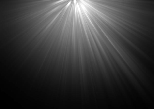 Raios de luz bonitos abstratos no fundo preto.
