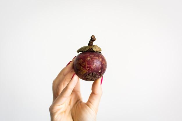 Rambutan na mão
