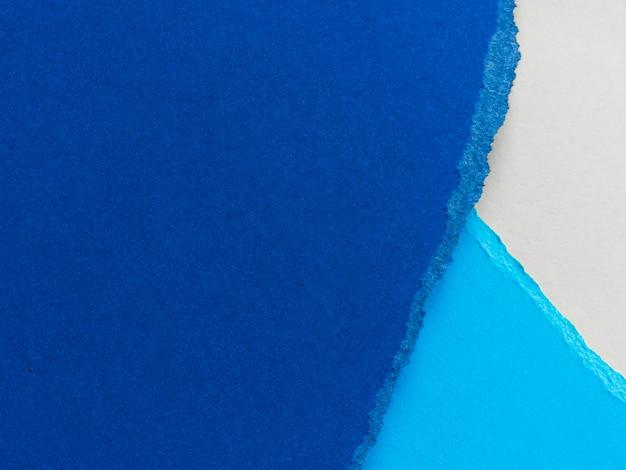 Rasgos em camadas de papel colorido