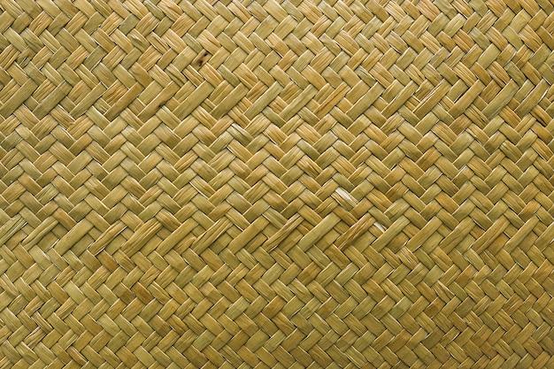 Rattan tecido trançado de vime natural, fundo da textura da grama do sedge