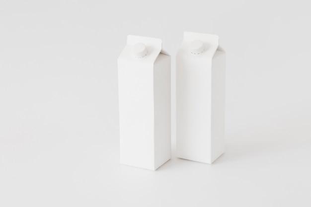 Recipientes de cartão para produtos lácteos