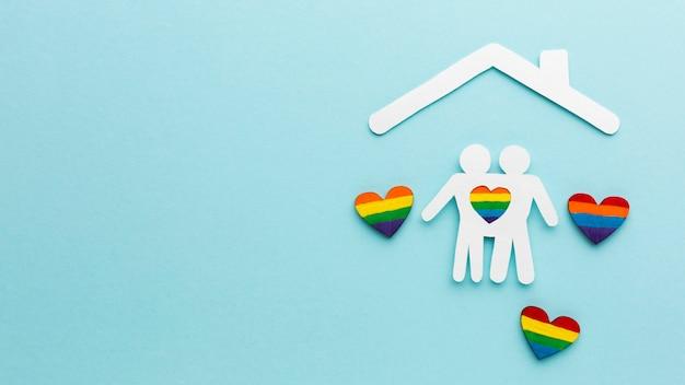 Recorte papel casal pessoas em uma casa