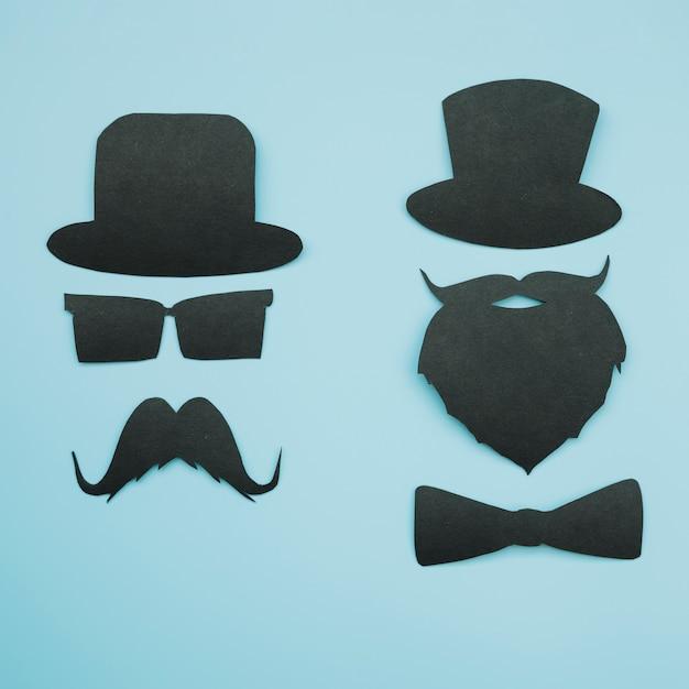 Recortes de papel de cavalheiros em chapéus