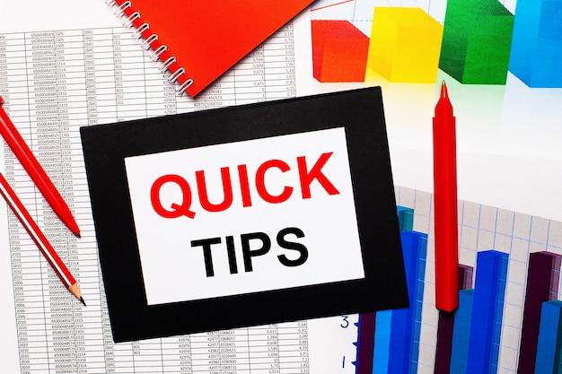 Relatórios e gráficos de cores estão na mesa. também há canetas vermelhas, lápis e papel em uma moldura preta com as palavras quick tips. vista de cima