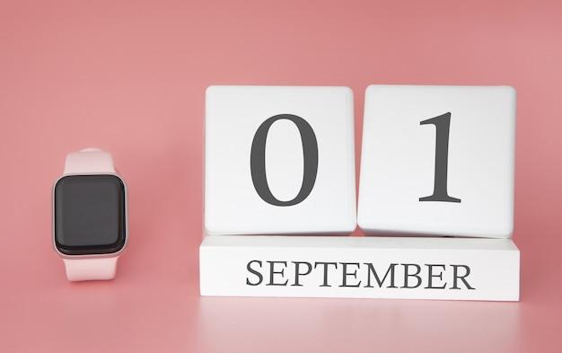 Relógio moderno com calendário de cubo e data 1 de setembro na parede rosa. conceito de férias de outono.