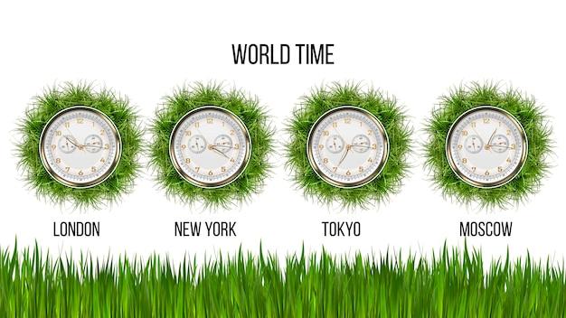 Relógio mostrando a hora em diferentes cidades. grama verde. hora mundial. conceito de ecologia do planeta. relógio do aeroporto. fundo branco isolado. copie o espaço.