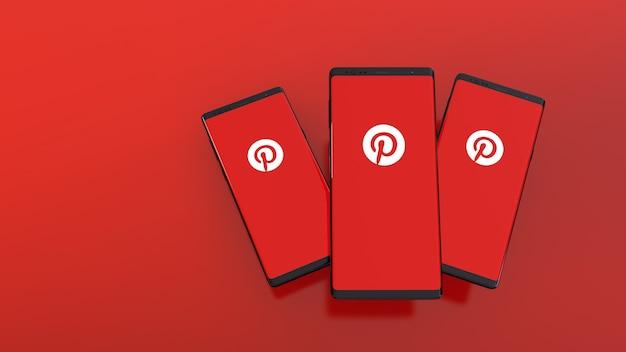 Renderização 3d de smartphones com o logotipo do pinterest na tela em vermelho