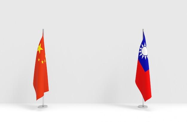 Renderização em 3d. dobrar o pódio de pólo de bandeiras nacionais da china e taiwan na parede do palco de cimento branco.