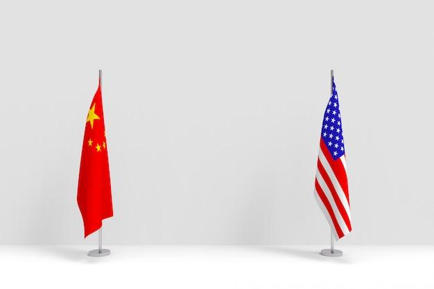 Renderização em 3d. pódio de pólo de bandeira nacional de china e eua em pé na parede de cimento branco.