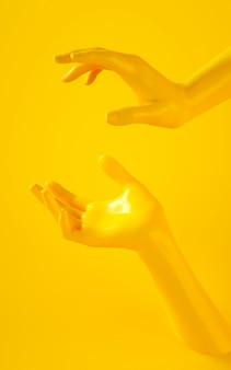 Renderização em 3d vertical de duas mãos amarelas sobre fundo amarelo