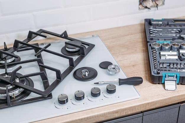 Repara o painel de controle do fogão a gás, fechar foto