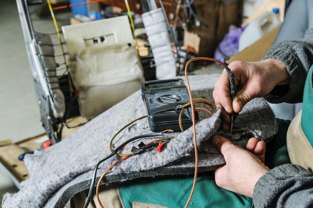 Reparação do aquecimento da cadeirinha.