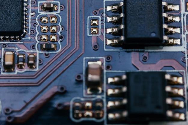 Reparo da placa de circuito. tecnologia moderna de hardware eletrônico. placa-mãe digital chip de computador pessoal. parede de ciência de tecnologia. processador de comunicação integrado. componente de engenharia da informação