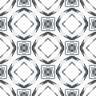 Repetindo a borda desenhada mão listrada. design chique do verão do boho imaculado preto e branco. impressão surpreendente pronta para têxteis, tecido de biquíni, papel de parede, embrulho. desenho listrado desenhado à mão.