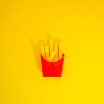 Réplica de batatas fritas em fundo amarelo