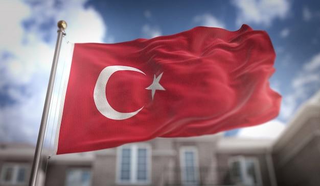Representação 3d da bandeira da turquia no fundo do edifício do céu azul
