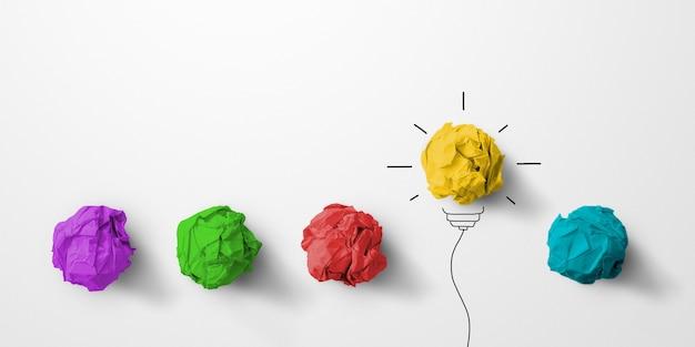 Resíduos de papel bola de cor amarela excelente grupo diferente com símbolo de lâmpada